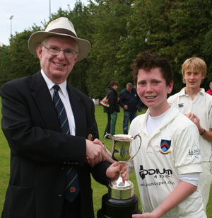 NCU President Dr Murray Power presents the Banoge Cup to winning captain Paddy Beverland ©John Boomer/CricketEurope