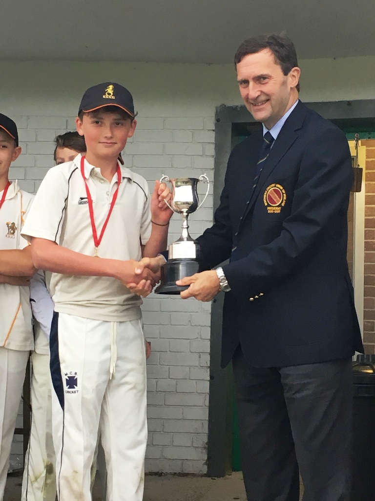 Matthew Humphreys receiving the trophy from NCU President Peter McMorran