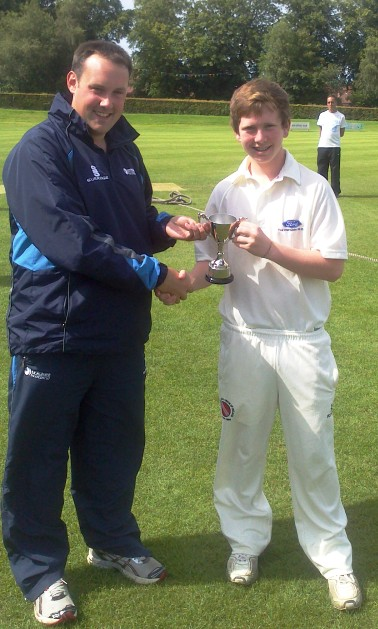Winning skipper Paddy Beverland receives the cup