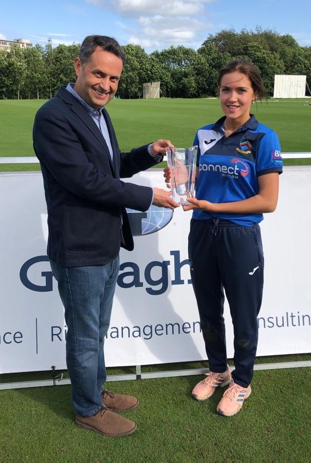Shane Matthews presents the Player of the Match Award to Abbie Leckey