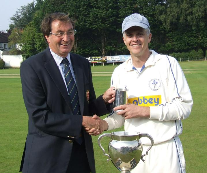 Simon Thompson receives the Man of the Match award from NCU President Chris Harte