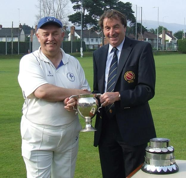 Ivan McCombe receives the Intermediate Cup from NCU President Chris Harte