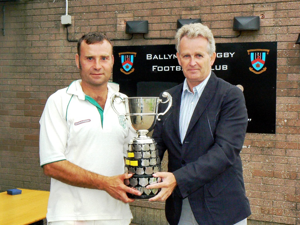 Graham Moreland receives the the trophy from Philip Black