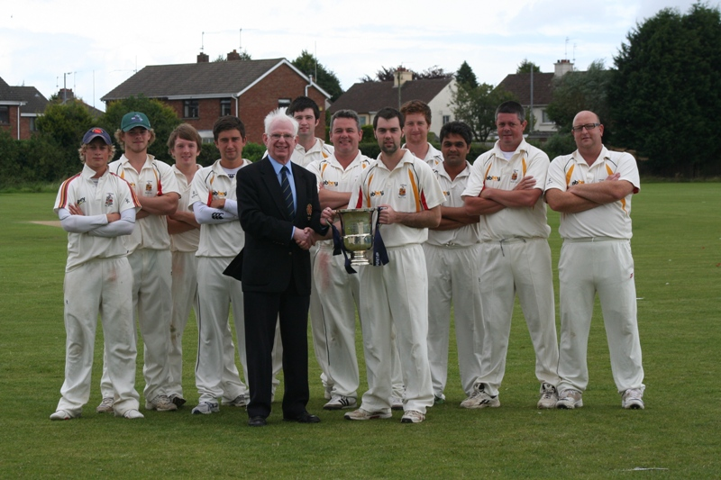 NCU President Dr Murray Power with Lurgan captain Steven Chambers and the Lurgan team who played Downpatrick