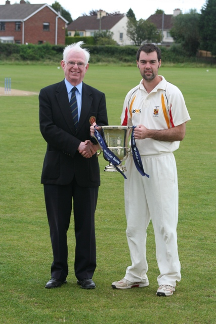 NCU President Dr Murray Power presents the Ulster Bank League Section One Trophy to Lurgan captain Steven Chambers