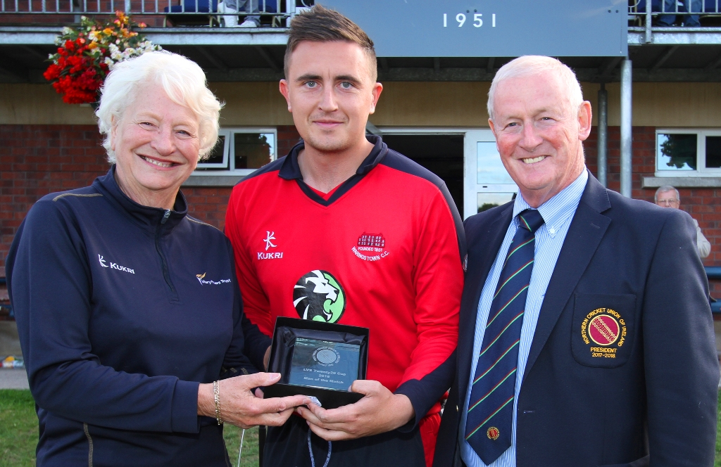 Dame Mary Peters presenting the Man of the Match award to Lee Nelson of Waringstown