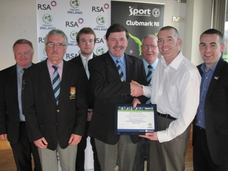 Carrickfergus Vice President and Northern Cricket Union Chairman Roger Bell receives the Club Accreditation Scheme certificate from Cricket Ireland's Tim Simmonite. They are alongside Sport Northern Ireland Performance Consultant Simon Toole and representatives from the club including Ireland international Paul Stirling.