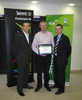 David Skelton receives the Club Accreditation Certificate from Tim Simmonite and Simon Toole of Sport NI