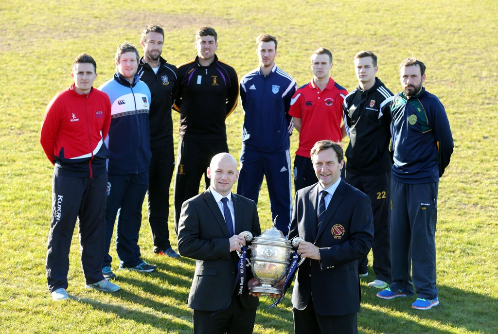 Top players from the eight Ulster Bank NCU Premier League sides with the league trophy they hope to win