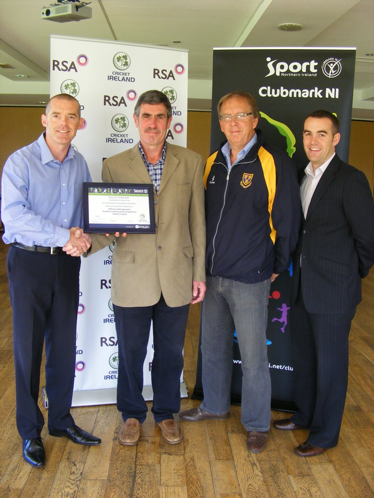 Saintfield CC Chairman Noel McCarey receives the Cricket Ireland / Clubmark NI certificate from Tim Simmonite, National Development Manager for Cricket Ireland. They are alongside William Radcliffe from Saintfield CC and Simon Toole, Performance Consultant for Sport NI
