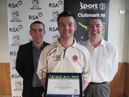 Templepatrick's Andy McCrea receives the Club Accreditation Scheme certificate with Sport Northern Ireland Performance Consultant Simon Toole and Cricket Ireland's Tim Simmonite