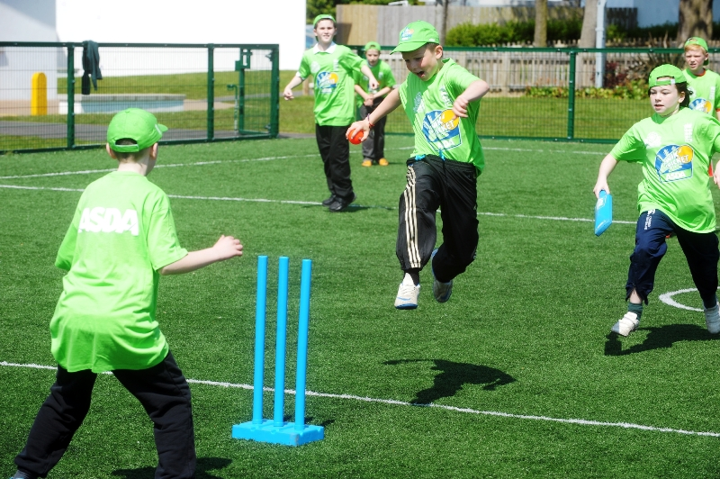 Action at the Asda Kwik Cricket launch at Orangefield Primary
