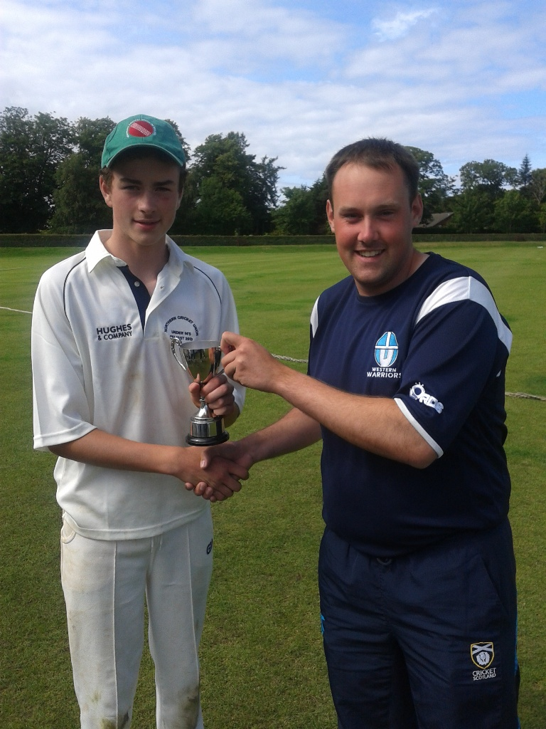 Belfast captain Hugh Gibbons receives the Charlie Beverland Memorial Cup from Cricket Scotland 's Tim Hart