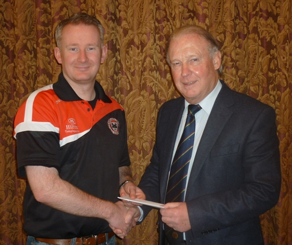Brian Walsh, Chairman of the NCU (right), presents Peter Shepherd with the prize of two tickets for Ireland versus England after winning the competition to name the NCU Inter-provincial limited overs cricket team.