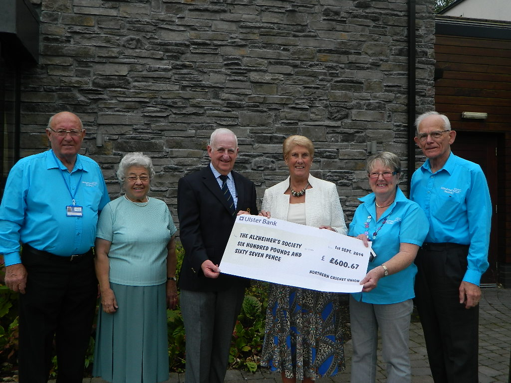 NCU President presents cheque to Alzheimer's Society
