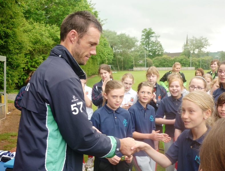 Nigel Jones presenting medals at the Asda Kwik Cricket Finals last season.